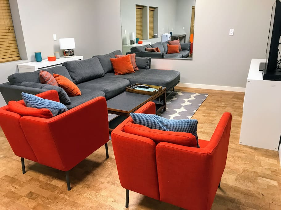 "[the nest] amenities ::  over-stuffed down-filled sectional sofa | two sitting chairs | 55"" TV + netflix, amazing, etc 