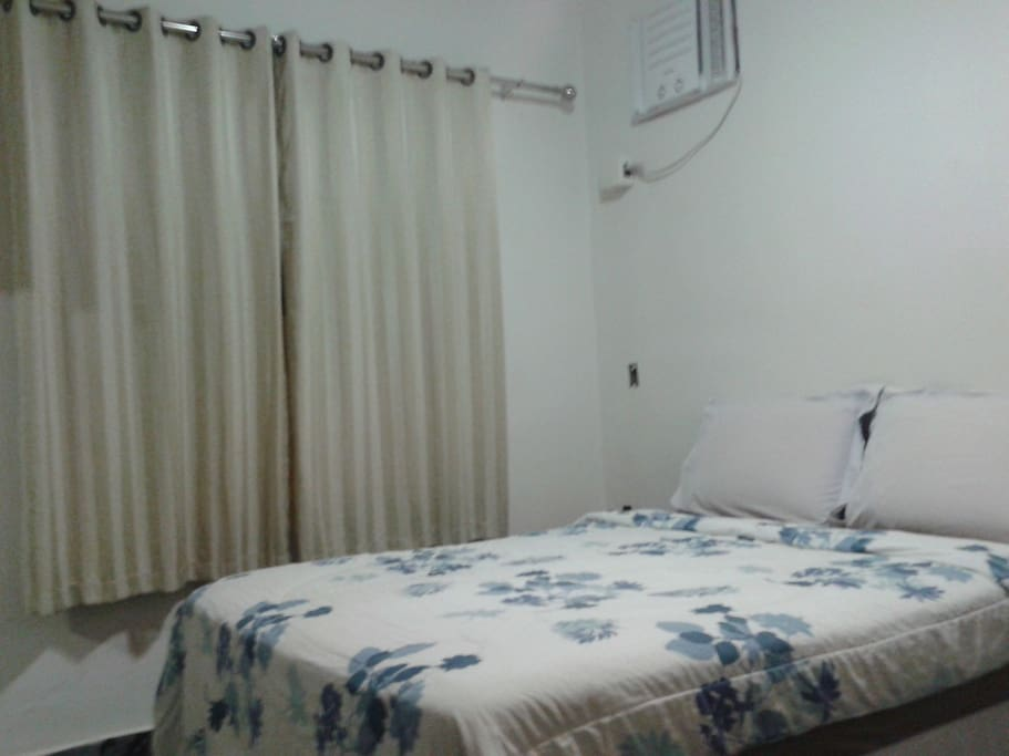 Bedroom with double bed and air conditioning.