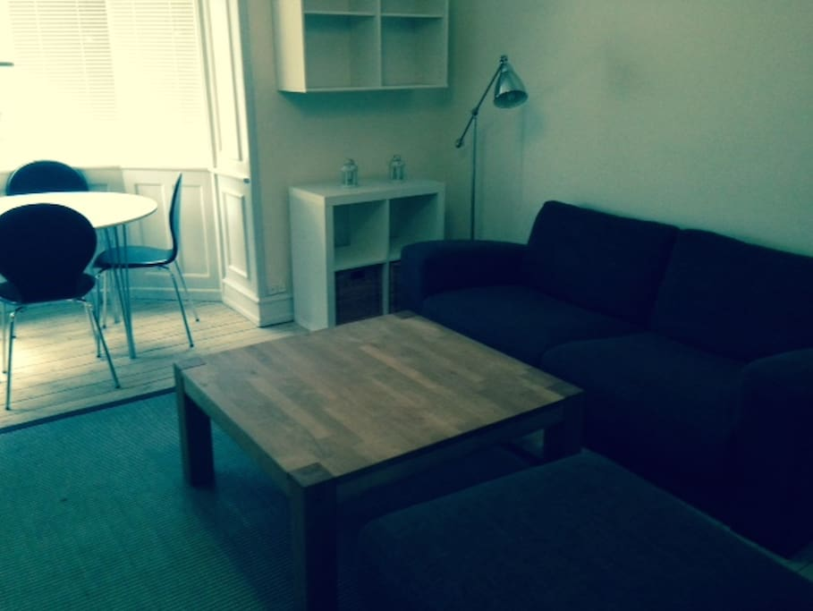 Dining room with a couch and a place to eat or work