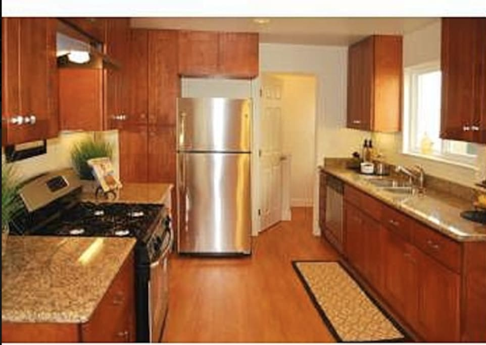 Kitchen with new stainless steel appliances, coffee maker, microwave, juicer, soda maker