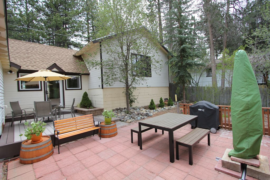 Spacious and private deck area with bbq and two eating tables.