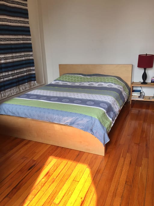Sun drenched bedroom with very comfortable queen size bed