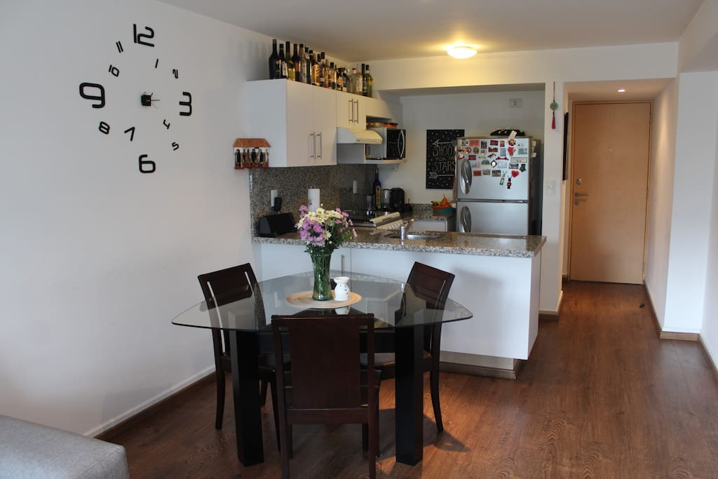 Dinning table and kitchen.