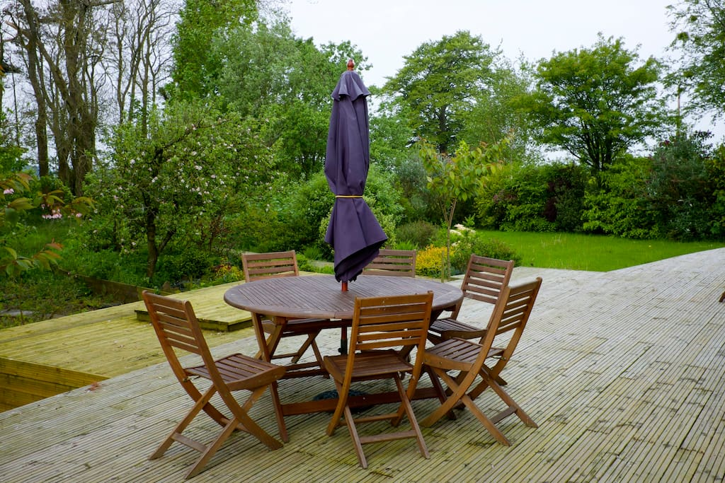 Large shared garden, access to outdoor dining.