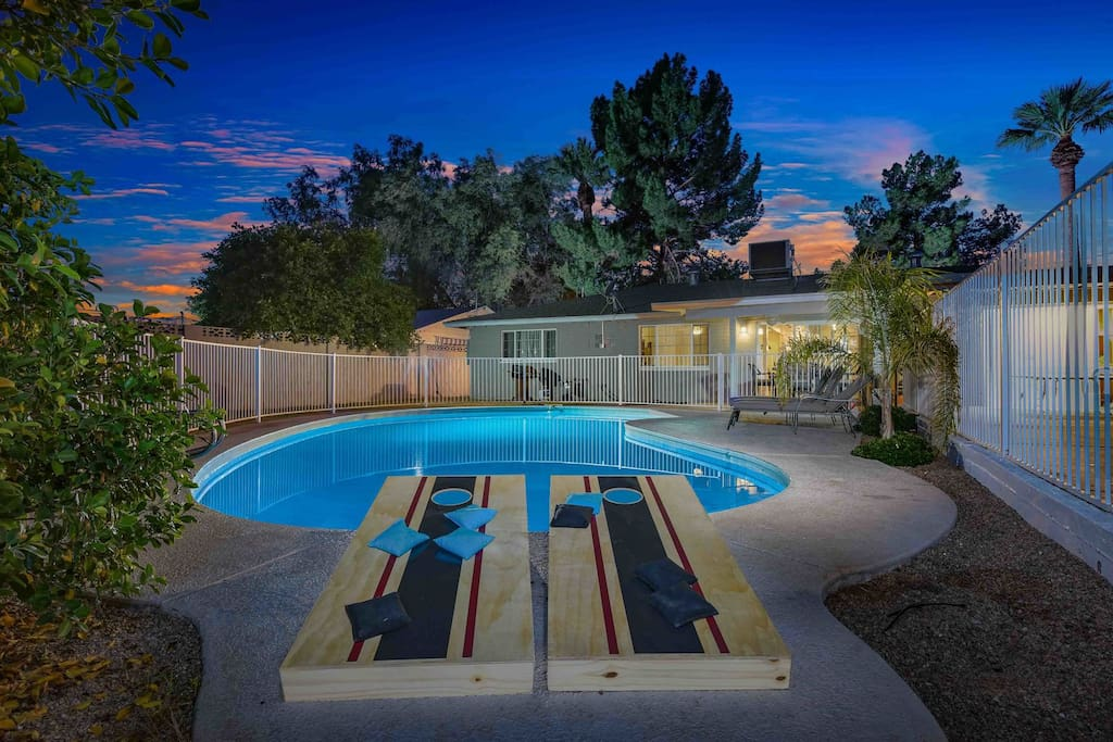 Enjoy a game of cornhole and swim in this private heated pool!