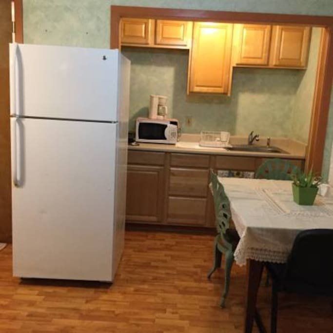 full refrigerator, microwave, coffeemaker, hot plate, includes silverware, dishes, pots