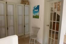 Wardrobe space and mirrored door to bathroom
