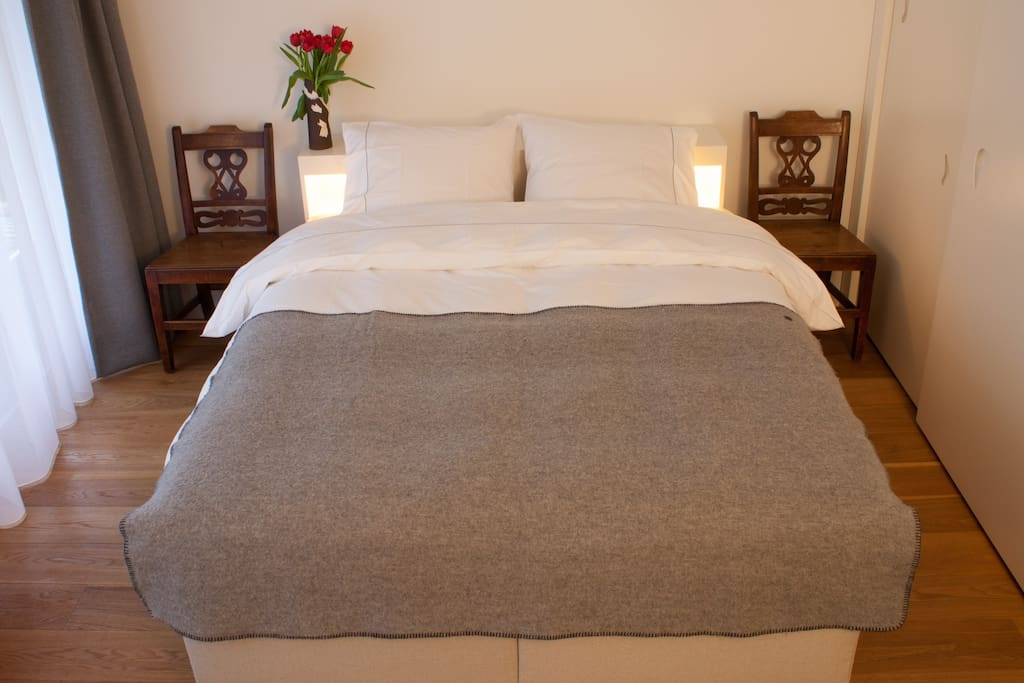 Luxury cotton bed linen on new double bed.