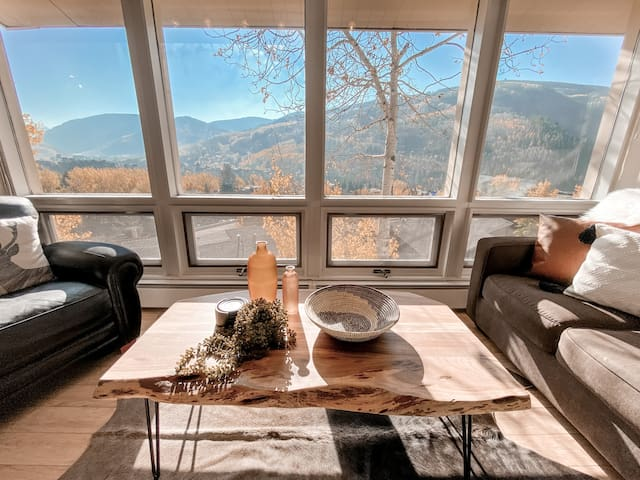 Floor-to-ceiling windows with a perfect view of Vail Mountain.