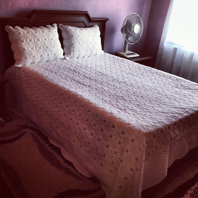 Big clean and comfortable double bed.
