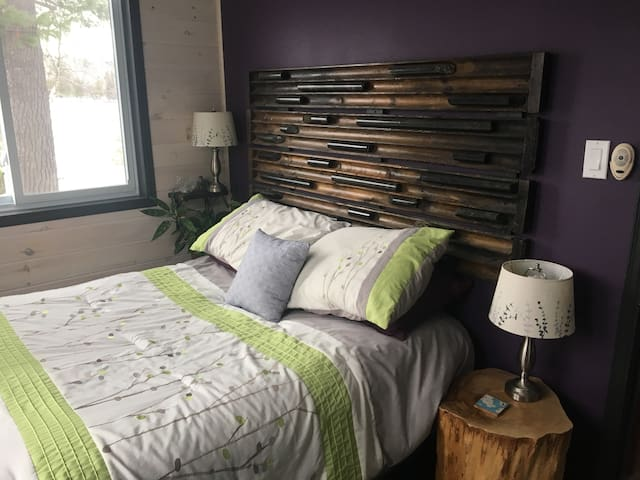 Bedroom one! With custom built (by me!) core sample headboard.