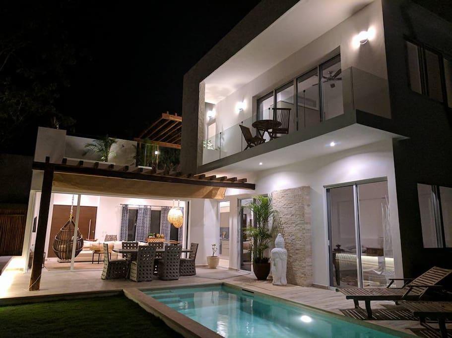 Villa 1 lit up at night