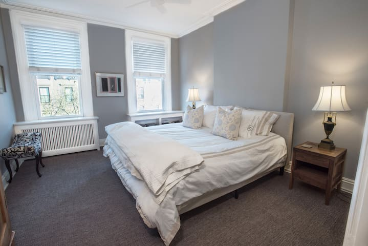 Spacious master bedroom with luxurious king bed looking east