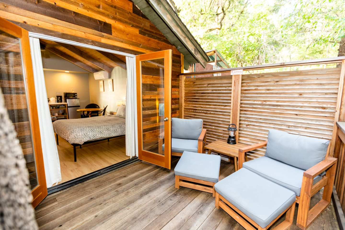 The cottage is a free-standing studio w/kitchenette, bathroom, and french doors leading out to a redwood deck overlooking a wooded ravine.