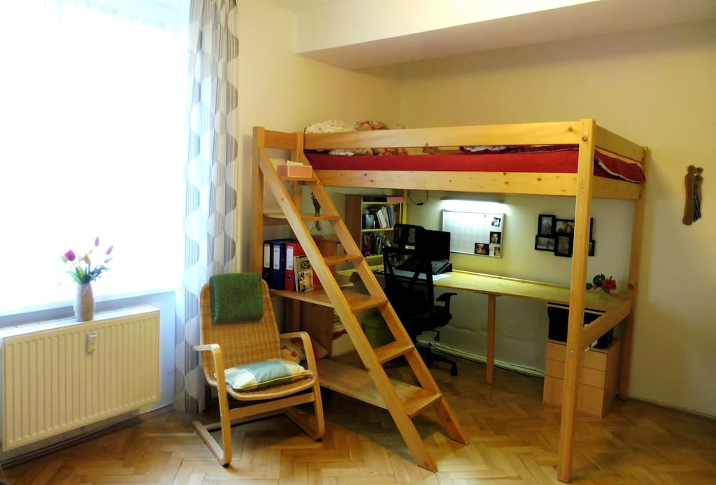 A bunk loft bed for two with a working area underneath