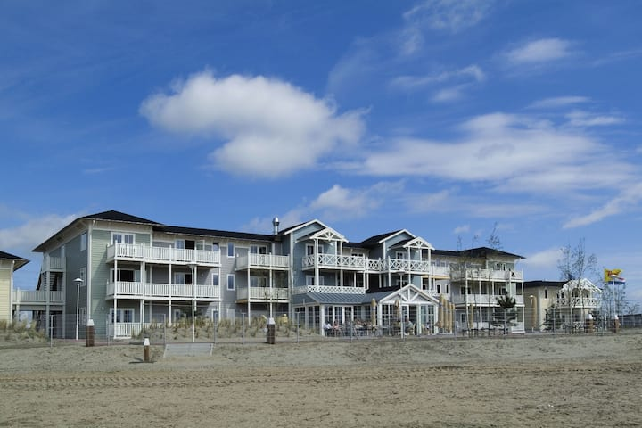 Adjusted hotel room with a balcony, near the beach