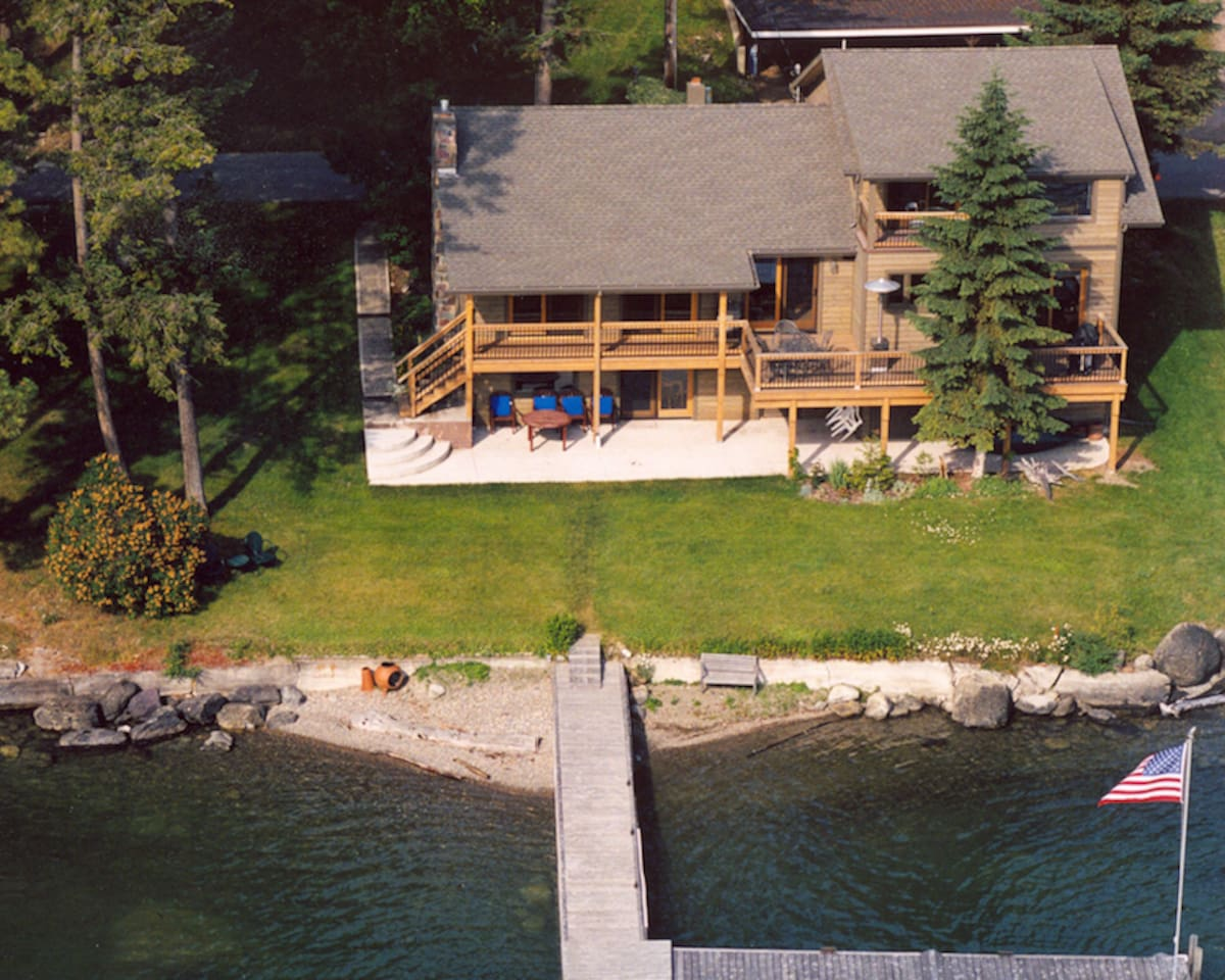 Your house sits directly on the shore of Flathead Lake in northwest Montana. We offer a unique rental opportunity with three floors, each a separate unit with its own bath and kitchen. The five bedrooms can accommodate a maximum of eight people. Single units also are available for rent to smaller parties. You will have exclusive use of the house, yard and dock, which can accommodate your boat.Each unit comes complete with clean linens, fully equipped kitchen, bathroom, outdoor grill and patio furniture. The house rents for $2,800 a week in the high season, July and August, Units rent from $150 a day to $400 a day for all three units,with a minimum stay required. You will not find a better value on the lake. Contact: joanieo@xmission.com