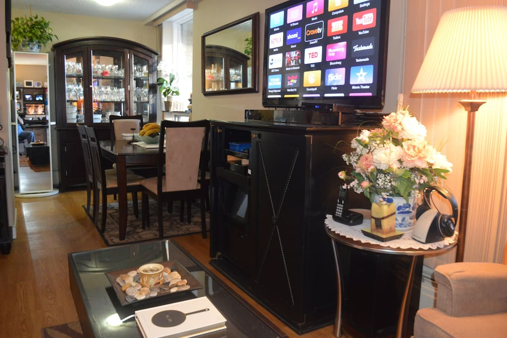 Dining for six, TV stand includes a mini-bar and Apple TV.
