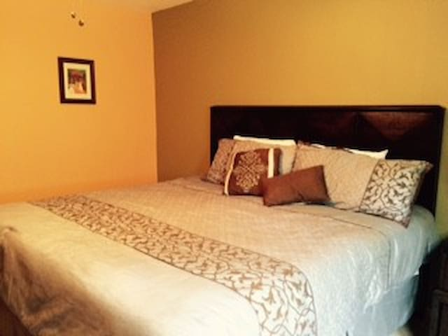 The Master bedroom is spacious and consists of a walk-in closet,  and a private bathroom and washing area. Beautifully decorated with dressers, night stand and a Smart T.V.