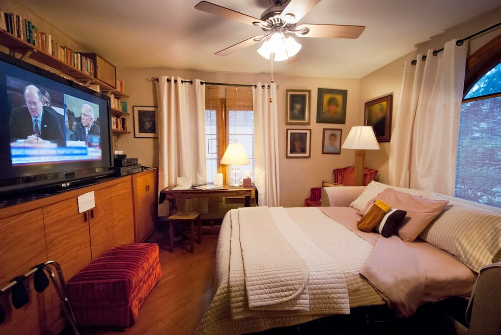 "This room includes a queen-size sofa bed with foam topper, large TV and a work table. Guest Q. says: ""First time to use Airbnb, nice experience. Lia and Garry are very nice and helpful. The bed is comfortable, even [for a] sofa bed. Perfect house."""