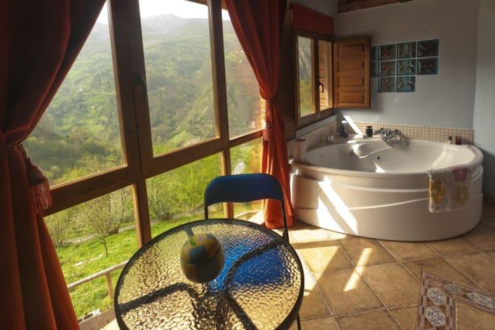 Jacuzzi con vistas y chimenea - proaza - House