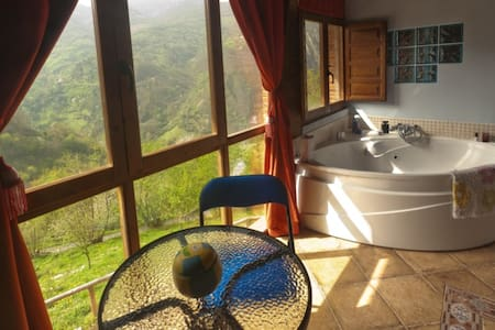 Jacuzzi con vistas y chimenea - proaza - Casa