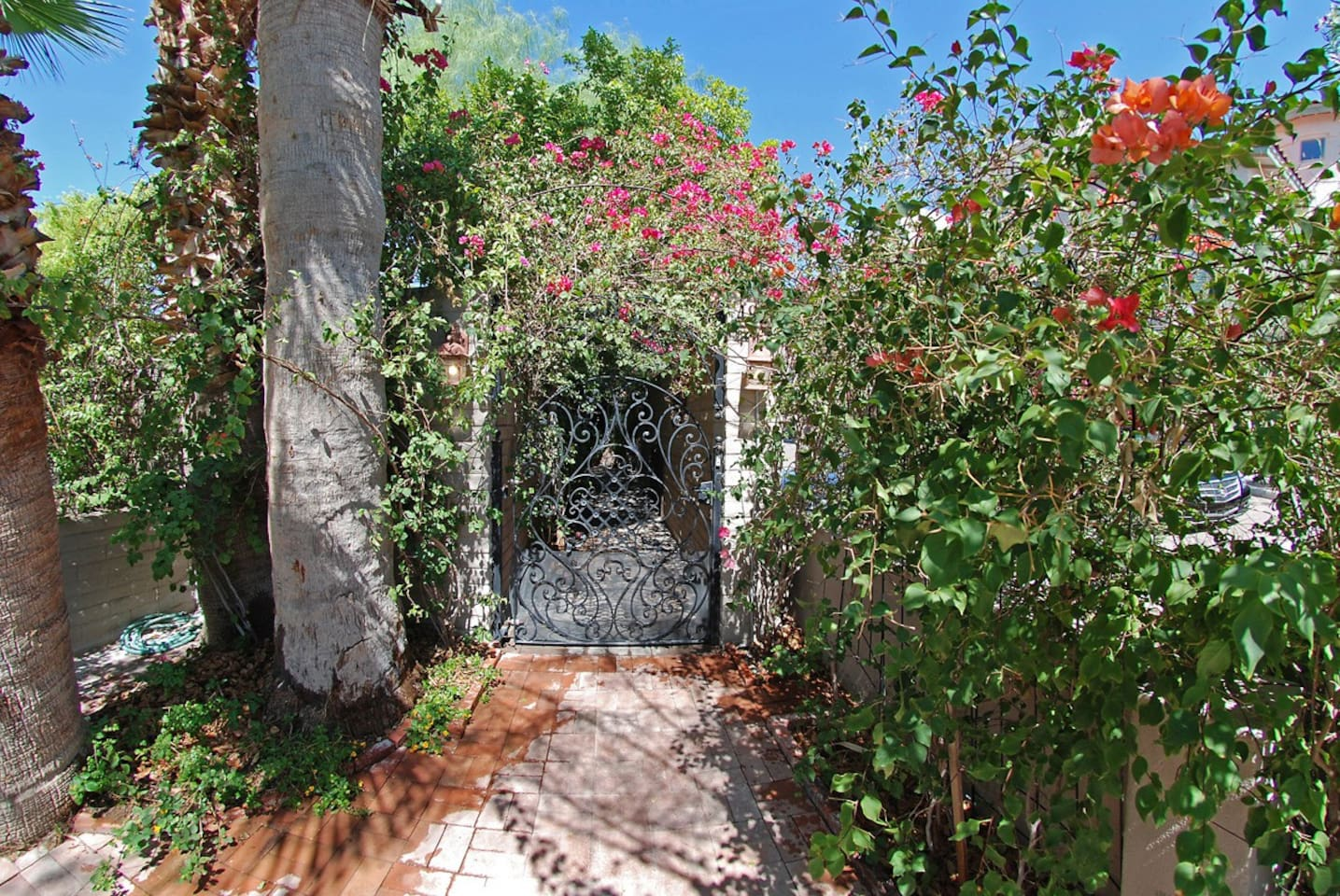 Charming private entry with hand made wrought iron gate