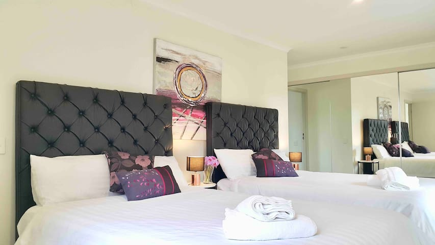 Master en-suite with 2 double beds, private bathroom and balcony