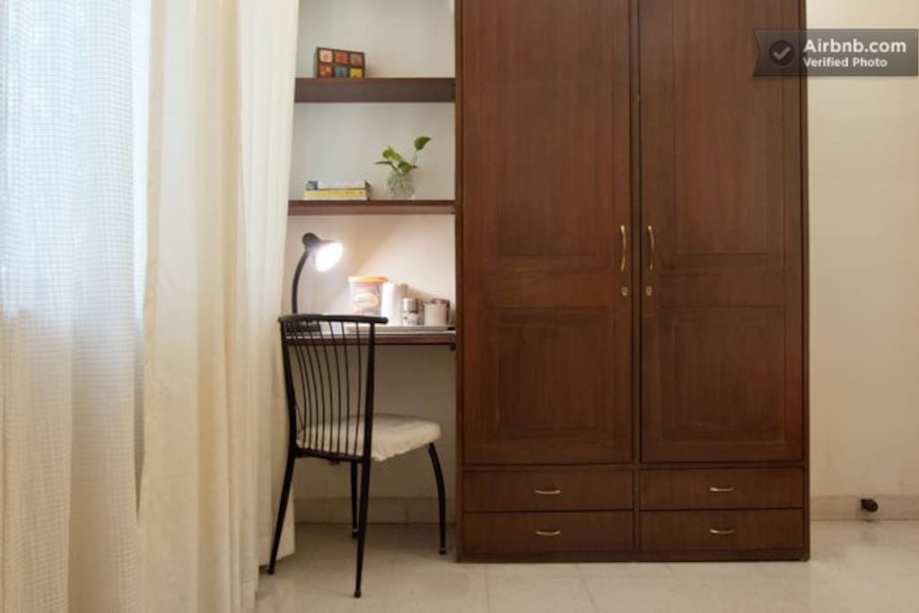 Built in desk, chair and secure wardrobes