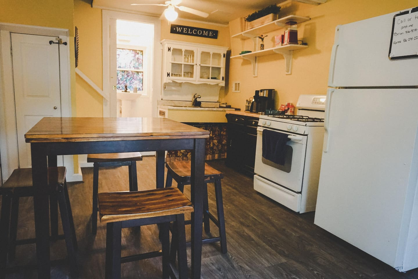 Totally repainted and new flooring, your kitchen comes equipped with everything you need to cook a lovely meal, or just nuke a burrito. Also a stylish dining room table