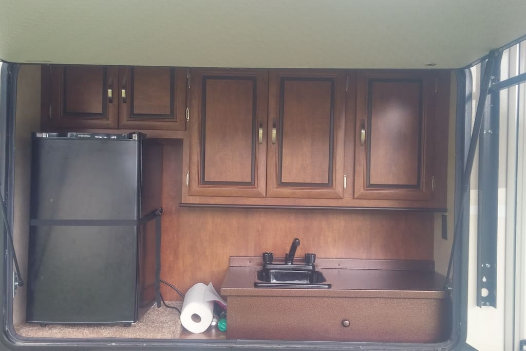 Out door kitchen with second fridge and sink