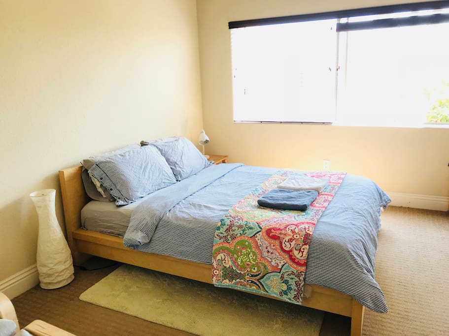 Queen size bed with comfortable bedding