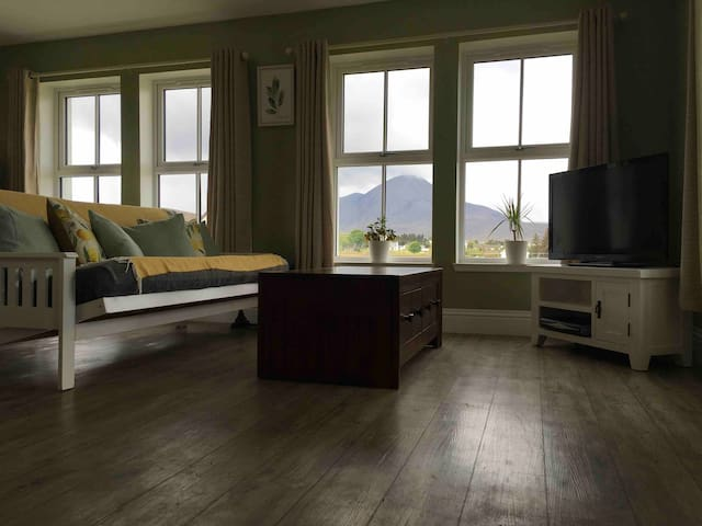 Livingroom with view of Beinn na Caillich