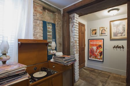One Bedroom Carriage House Basement | Downtown