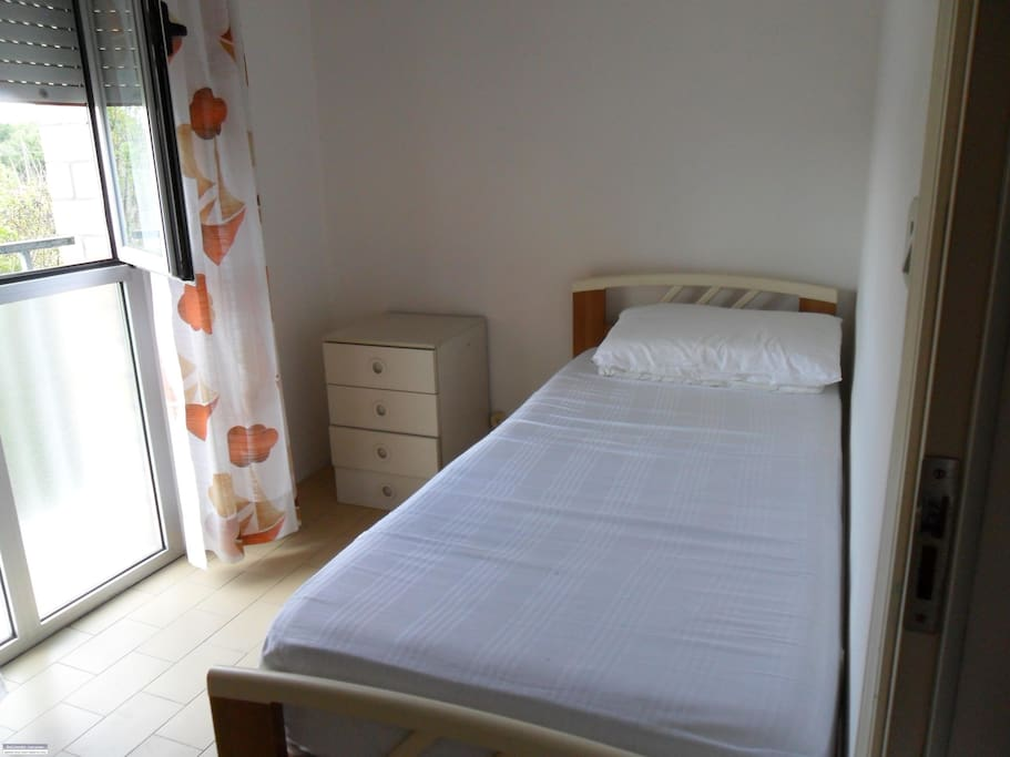 2nd bedroom with 2 singles bed