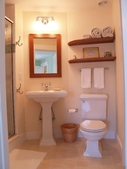 The en suite bathroom, also a Hutchison design, has a tiled shower and plenty of towel space. Edgartown, Martha's Vineyard.