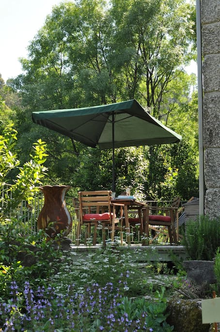 The deck. This is facing east.Perfect for breakfast in the morning.With the sound of the stream passing through the woodland below,in the distance the medieval tower of the 'Torre de Aguia' and vineyards.
