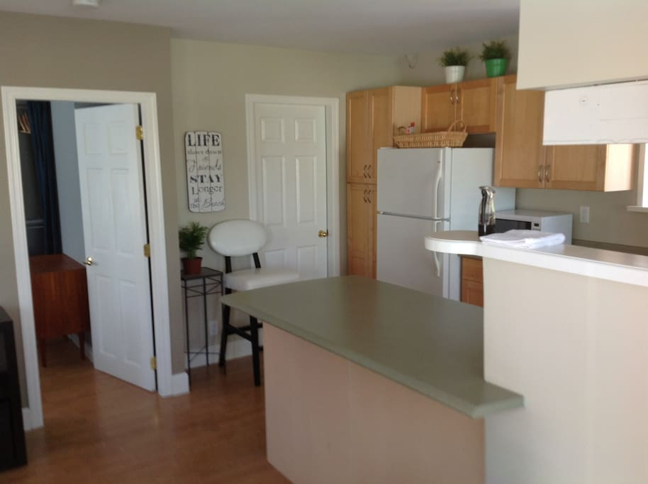 FULLY EQUIPPED KITCHEN WITH DISHWASHER AND WASHER, DRYER