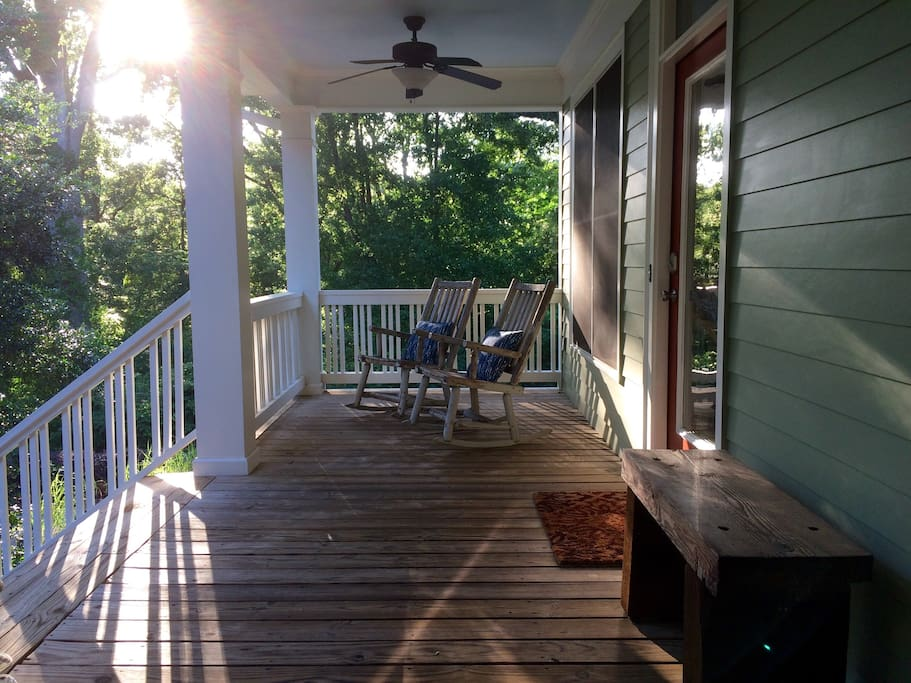 Front porch with great views...wooded  surroundings and downtown at your doorstep.