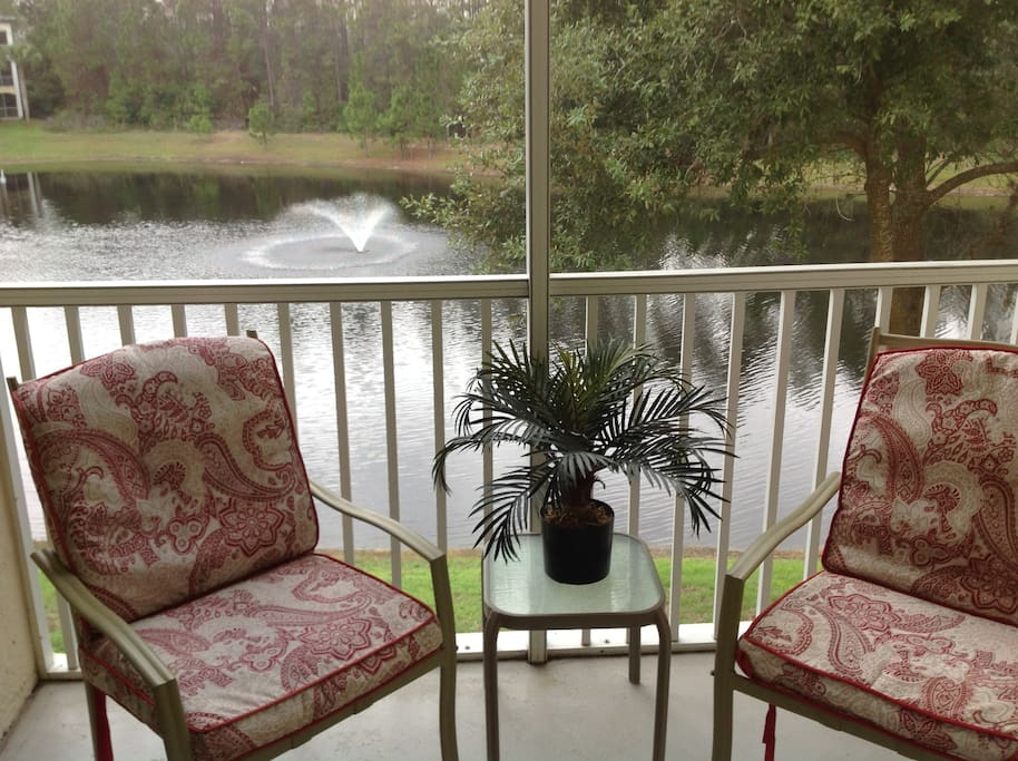 screened balcony with a private view of the lake