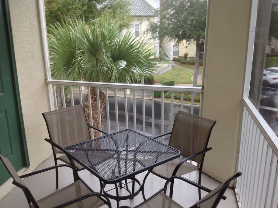 The sliding glass doors open up to our screened balcony