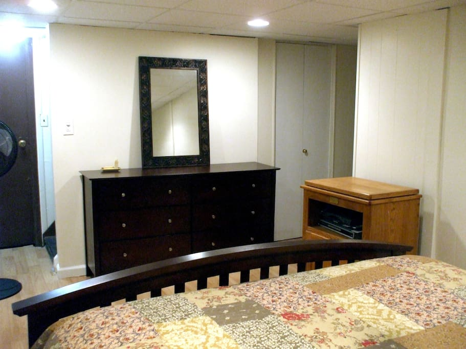 New dresser with empty drawers for your items, closet with shelves, cable TV (not pictured), large mirror.