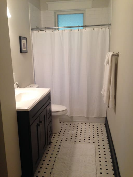 New meets old. Completely new bathroom with vintage style tile around shower and on floor.