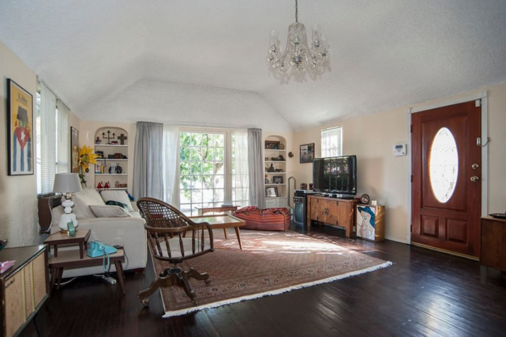 Front door opens to large living room with eclectic decorative touches all through this house