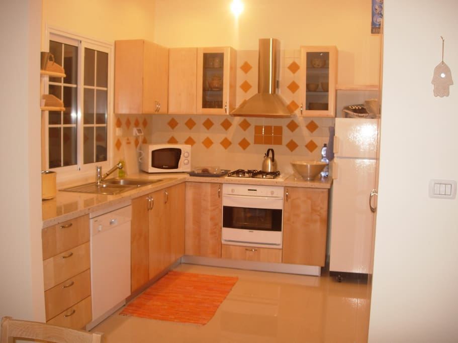 Cuisine, Kitchen with over, microwave, dishwasher.