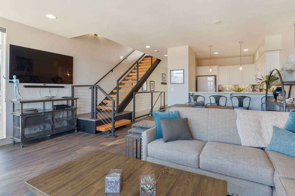 Spacious light filled living space with plenty of comfortable seating.