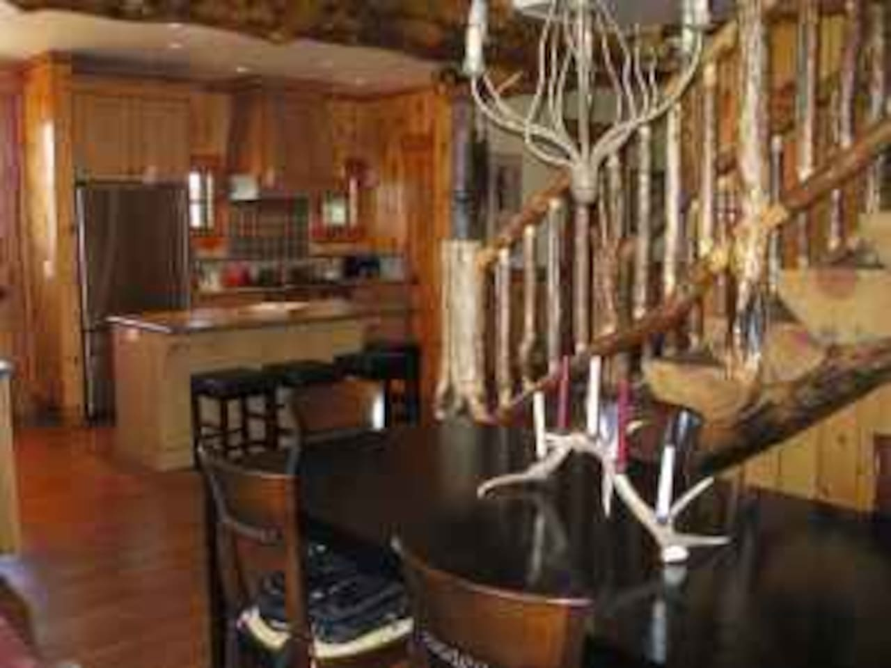 split log staircase and open kitchen