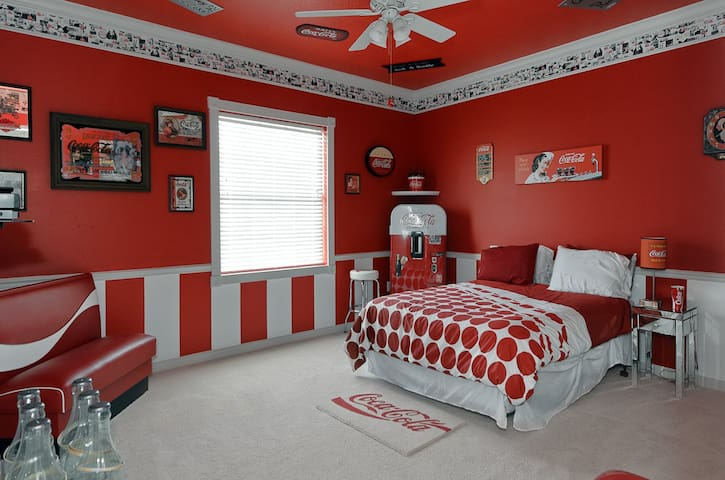 The Coca-Cola bedroom features an authentic coke machine, ring toss game, and more...