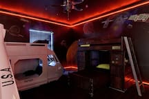 The Milky Way Galaxy Room features a bed with a slide, laser tag, a tablet built into the wall, and more..