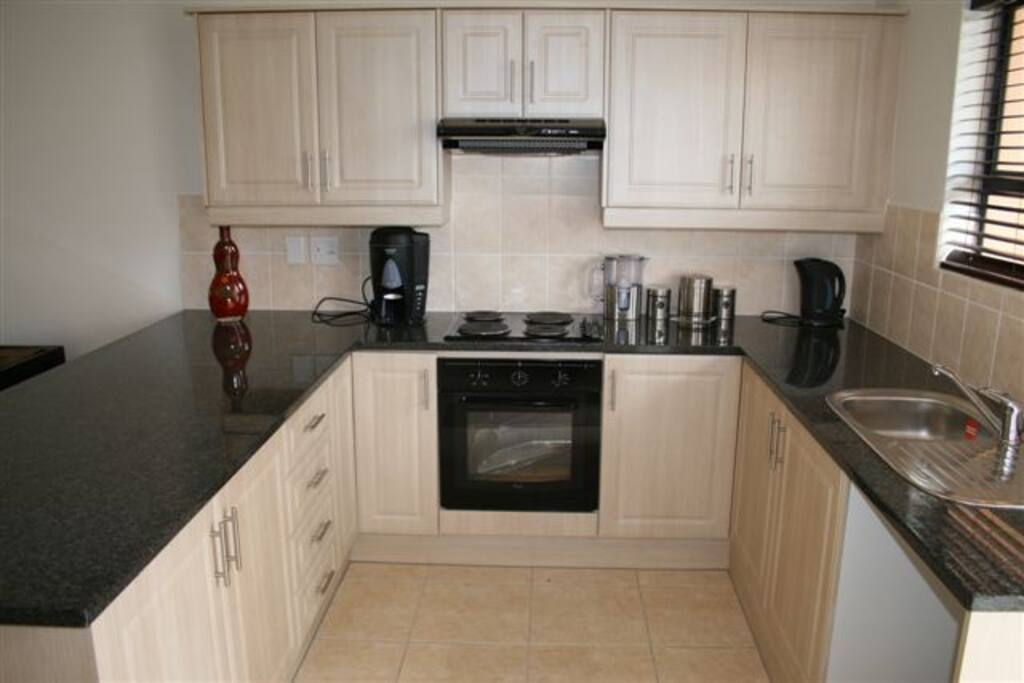 includes kettle, fridge, microwave & oven
